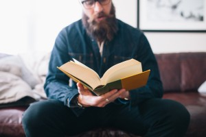 image of man reading a book